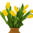 Flower bouquet from yellow tulips in brown vase isolated on whi — Stock Photo