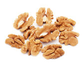 Heap of fresh shelled walnuts on white background. Close-up. — Stock Photo