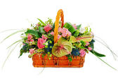 Flower bouquet arrangement centerpiece in a wicker gift basket i — Stock Photo