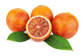 Ripe red blood oranges with cut and green leaves isolated on whi — Stock Photo