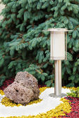 Solar-powered lamp on garden background. — Stok fotoğraf
