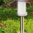 Stock Photo: Solar-powered lamp on garden background.