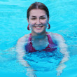 Young beautiful woman in swimming pool. — Stock Photo