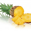 Stock Photo: Ripe pineapple with slices isolated on white background.