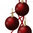Foto de Stock  : Christmas balls hanging with tapes isolated on white background.