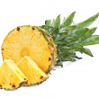 Ripe pineapple with slices isolated on white background — Stock Photo #29976297