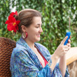 Portrait of smiling beautiful woman texting with her phone. — Stock Photo