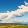 Stock Photo: Landscape with mountain views, blue sky and beautiful clouds.
