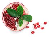 Pomegranate fruit with green leaves isolated on white background — Stock Photo