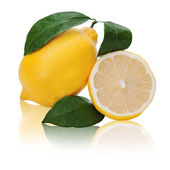 Fresh lemon citrus with cut and green leaves isolated on white b — Stock Photo