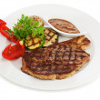 Grilled steaks, baked potatoes and vegetables on white plate. — Stock Photo