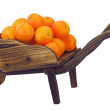 Stock Photo: Oranges on pushcart isolated on white.