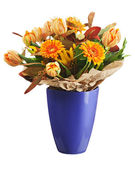 Colorful bouquet from tulips and gerbera flowers isolated on whi — Stock Photo
