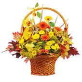 Colorful flower bouquet arrangement centerpiece in wicker basket — Stock Photo