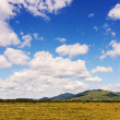 Stock Photo: Landscape with mountain views, arable land, blue sky and beautif