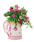 Colorful flower bouquet from roses and fruits in vase isolated o — Stock Photo