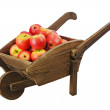 Red apples on wooden pushcart isolated on white background. — Stock Photo