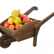 Red apples and pears on wooden pushcart isolated on white backgr — Stock Photo