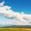 Landscape with mountain views, blue sky and beautiful clouds. — Stock Photo #36956681