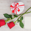 Stock Photo: Valentines Day gift, heart and paper on wooden background.