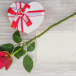Valentines Day gift, heart and paper on wooden background. — Stock Photo #37365979