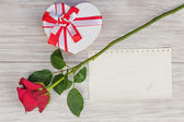 Valentines Day gift, heart and paper on wooden background. — Stock Photo
