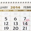 Stock Photo: Calendar page with red heart on February 14 2014.