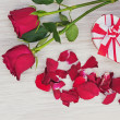 Valentines Day gift, roses and paper on wooden background. — Stock Photo #38682259