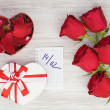 Valentines Day gift, roses and paper on wooden background. — Stock Photo #38682337