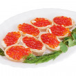 Tartlets with red caviar on plate isolated on white background. — Stock Photo