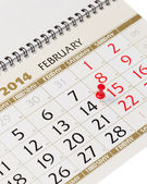 Calendar page with red thumbtack on February 14 2014. — Stock Photo