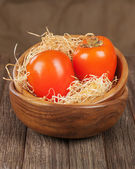 Fresh ripe persimmon in bowl on wooden table. — Stock Photo