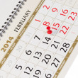 Stock Photo: Calendar page with red thumbtack on February 14 2014.