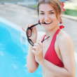 Young beautiful smiling girl near swimming pool. — Stock Photo
