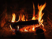Fireplace with birch firewood and flame. — Stock Photo