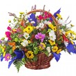 Flowers bouquet arrangement centerpiece in wicker basket isolate — Stock Photo #41468753