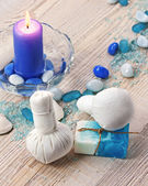 Spa massage setting with thai herbal compress stamps. — Stock Photo