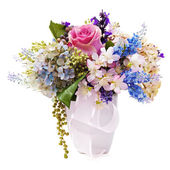 Bouquet from artificial flowers arrangement centerpiece in vase — Stock Photo