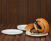 French buns with poppy seeds on saucer plate. — Stock Photo