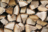 Dry chopped firewood logs in pile. — Stock Photo