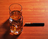 Highball whiskey glass with ice and cigar on wooden background.  — Stock Photo