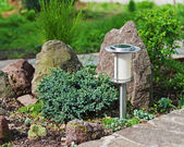 Solar-powered lamp on garden background.  — Stock Photo