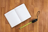 Blank notepad with office supplies on wooden table. — Foto de Stock
