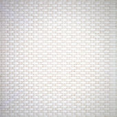 White cream plastic surface with a repeating pattern. — Stock Photo