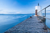 Old pier and calm sea — Stock Photo