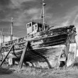 Dilapidated old fishing boat - Stock Photo