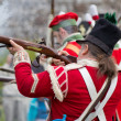 Stock Photo: Redcoat soldiers firing rifles