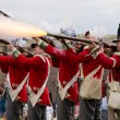 Redcoat soldiers firing rifles — Stock Photo