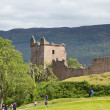 Tourists at Urquhart Castle — Stock Photo