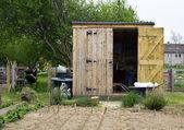 Wooden shed with open door — ストック写真